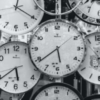 black-and-white-photo-of-clocks-707676-scaled-1886x943